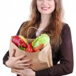 Woman holding a grocery bag full of fresh vegetables isolated on white — Stock Photo #14949069