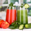 Fresh vegetable juices on wooden table, on window background — Stock Photo #14949233