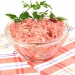 Bowl of raw ground meat isolated on white -  