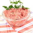 Bowl of raw ground meat isolated on white - Photo