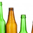 Colorful empty glass bottles isolated on white — Stock Photo #14949749