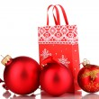 Royalty-Free Stock Photo: Christmas paper bag for gifts with christmas toys isolated on white
