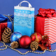 New Year composition of New Year's decor and gifts on blue background - 图库照片