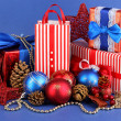 New Year composition of New Year's decor and gifts on blue background - Стоковая фотография