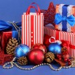 New Year composition of New Year's decor and gifts on blue background - Stockfoto