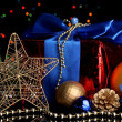 New Year composition of New Year's decor and gifts on Christmas lights background - Stockfoto
