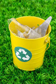 Recycling bin on green grass — Stock Photo