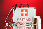 First aid box, on red background — Stock fotografie