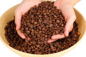 Coffee beans in hands isolated on white — Stock Photo