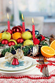 Serving Christmas table on room background — Stock Photo