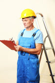 Builder enters into contract on work on wall background — Stock Photo