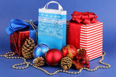 New Year composition of New Year's decor and gifts on blue background — ストック写真