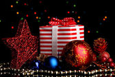 New Year composition of New Year's decor and gifts on Christmas lights background — Stock Photo