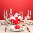 Royalty-Free Stock Photo: Table setting in red tones on color  background