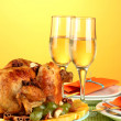 Banquet table with roasted chicken on orange background close-up. Thanksgiving Day - ストック写真