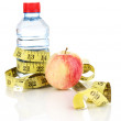 Stock Photo: Bottle of water, apple and measuring tape isolated on white