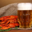 Stock Photo: Tasty boiled crayfishes and beer on table on brown background