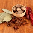 Nutmeg and other spices on wooden background — Stock Photo #14955647