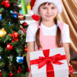 Little girl with Christmas toys in festively decorated room — Stock Photo #14956017