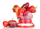 Fresh red vegetables in scales isolated on white — Stock Photo