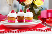 Delicious cupcakes with cream air on festive table close-up — Stock Photo