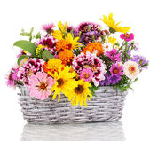 Beautiful bouquet of bright flowers in basket isolated on white — Foto de Stock