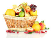 Assortment of exotic fruits in basket, isolated on white — Stock Photo