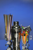Cocktail shaker and other bartender equipment on color background — Stock Photo