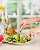 Female hand with dinner on bright background — Stock Photo