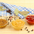 Stock Photo: Various sauces on bamboo mat