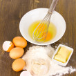 Eggs, flour and butter close-up on wooden table — Stock Photo #15312975