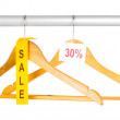 Royalty-Free Stock Photo: Wooden clothes hangers as sale symbol isolated on white