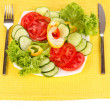 Stock Photo: Chopped vegetables and sauce on plate isolated on white