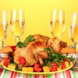 Banquet table with roast chicken on orange background close-up. Thanksgiving Day — Stock Photo #15313569
