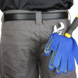 Gloves and instruments in back pocket close-up - 图库照片