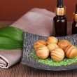Aromatherapy setting on brown background — Stock Photo #15314595