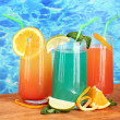 Three coctails on blue background — Stock Photo #15315149