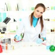 Stock Photo: Young scientist with Petri dish in laboratory