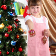 Little girl with Christmas toys in festively decorated room — Stock Photo #15315703