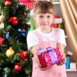 Little girl with Christmas toys in festively decorated room — Stock Photo #15315705