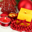 Royalty-Free Stock Photo: Yellow candle with christmas decoration on light background