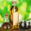 Olive oil bottle and small decanter on green background — Stock Photo #15315935