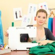 Beautiful young dressmaker in workroom — Stok fotoğraf
