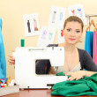 Beautiful young dressmaker in workroom — Stock Photo #15317031