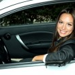 Beautiful young woman in car — Stock Photo #15317501