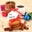 Royalty-Free Stock Photo: Cookies for Santa: Conceptual image of ginger cookies, milk and christmas decoration on light background