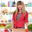Beautiful girl in kitchen while cooking — Stock Photo