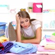 Stock Photo: Young girl tired ironing in room