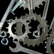 Machine gear, metal cogwheels, nuts and bolts isolated on black — Stock Photo