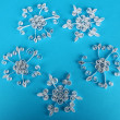 Beautiful paper snowflakes, on blue background — Foto Stock